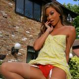 """""""Natalia is sheer perfection in and out of her short yellow summer dress and stockings."""""""