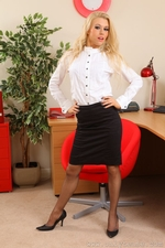 Michelle Moist In The Office With Knee Length Skirt And Grey Stockings And Suspenders - Picture 1