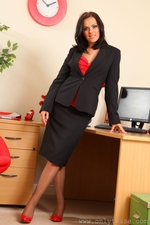 Abbie Teases Her Way From Office Outfit With Red And Black Suspenders - Picture 1