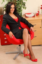 Abbie Teases Her Way From Office Outfit With Red And Black Suspenders - Picture 2
