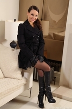 Carla Strips From Mysterious Black Outfit - Picture 2