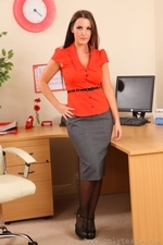 Eva N In The Office Revealing Her Red Lingerie And Suspenders - Picture 1